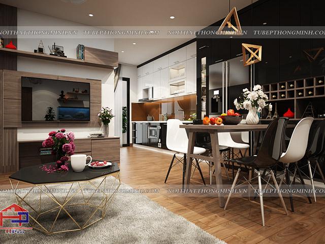 Không gian phòng bếp bằng gỗ công nghiệp acrylic bóng gương được thiết kế liên thông với phòng khách để đảm bảo được sự thông thoáng cho gia đình