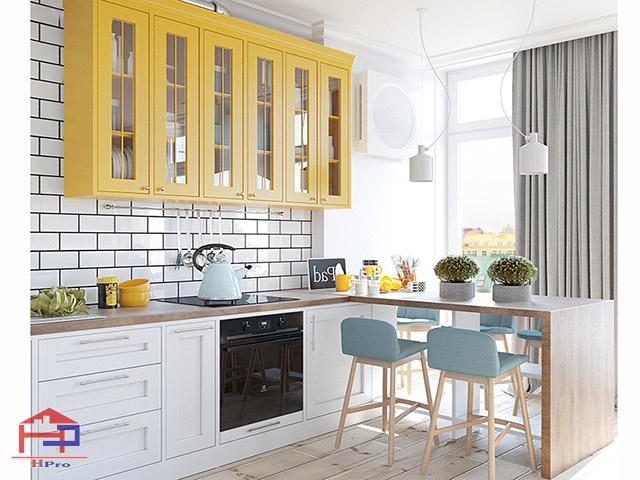 Sự kết hợp giữa màu trắng và màu trắng ấn tượng trong không gian phòng bếp bằng gỗ công nghiệp mang đến một không gian trẻ trung, ấn tượng