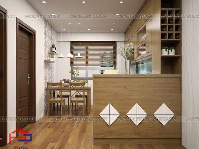 Không gian phòng bếp bằng gỗ sồi mỹ tự nhiên dành cho nhà chung cư với diện tích nhỏ hẹp được bố trí một cách khoa học nhất. Tủ bếp và bàn ăn được thiết kế đơn giản, bố trí gọn gàng trong gian bếp