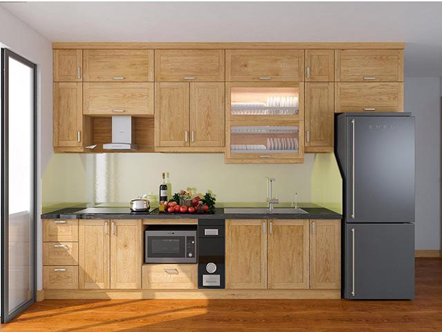 Không gian phòng bếp nhỏ hẹp được bố trí bộ tủ bếp dọc theo chiều dài bức tường và đặt ở sát tường đảm bảo cho công việc nấu nướng vẫn diễn ra một cách thoải mái và tiện nghi nhất