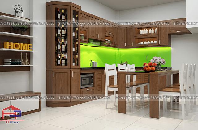 Chất liệu gỗ sồi mỹ tự nhiên với tone màu nâu sậm sang trọng kết hợp cùng bộ bàn ăn cùng chất liệu. Điểm nhấn của không gian đó là ghế ăn không dùng màu gỗ mà được sơn trắng để tạo nên sự rộng rãi cho phòng bếp