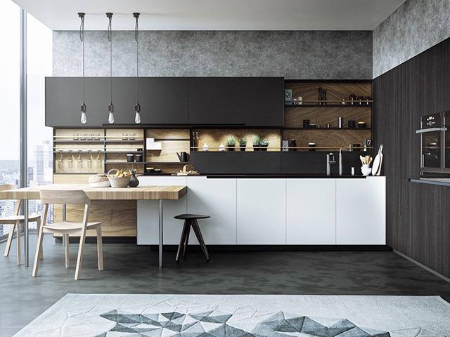 Phòng bếp đẹp bằng gỗ công nghiệp laminate với tone màu trắng kết hợp màu đen sang trọng. Thiết kế hiện đại, tích hợp đầy đủ công năng cần thiết trong bộ tủ bếp để mang lại cho gia đình một gian bếp hoàn hảo nhất