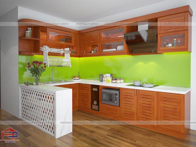 Mẫu phòng bếp bằng gỗ xoan đào đẹp với màu cánh gián sang trọng được thiết kế với điểm nhấn ấn tượng là bàn đảo bếp họa tiết lạ mắt màu trắng tinh khôi mang đến sự hiện đại cho gian bếp ấm cúng